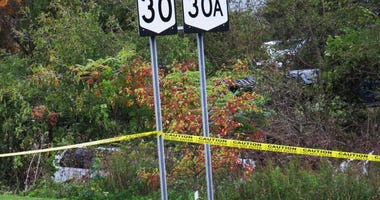 In this Oct. 6, 2018, file photo, a limousine, left, has landed in the woods following a fatal crash in Schoharie, N.Y.
