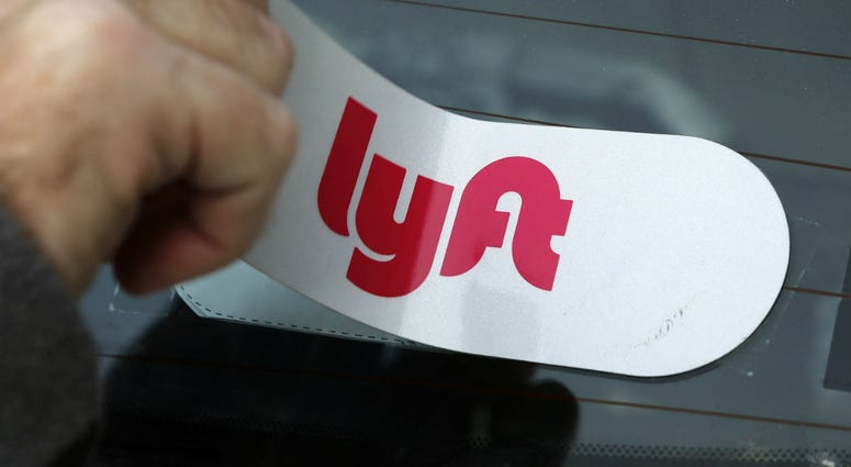Lyft sticker applied to the rear window so a car