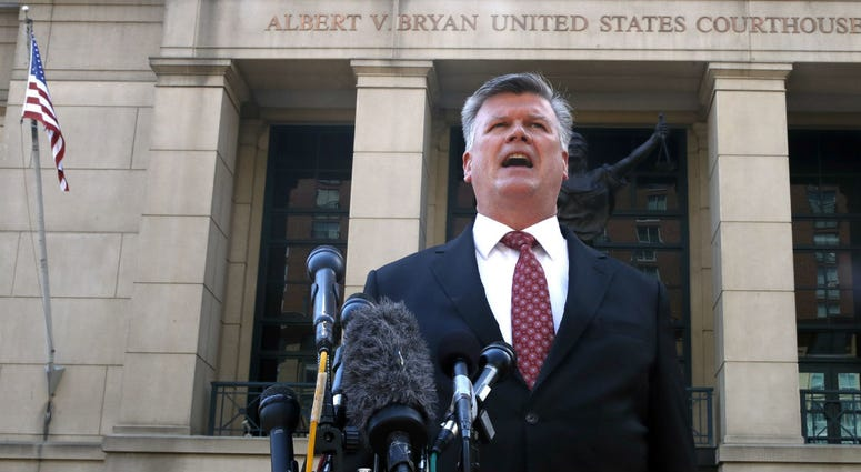 Defense attorney Kevin Downing makes a statement to the media after leaving federal court in the trial of former Donald Trump campaign chairman Paul Manafort, in Alexandria, Va., Tuesday, Aug. 14, 2018.