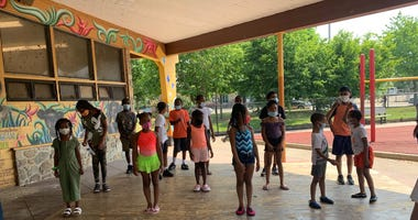 Philly summer campers practice social distancing while waiting for the Sprayground to open at.Mander Playground.