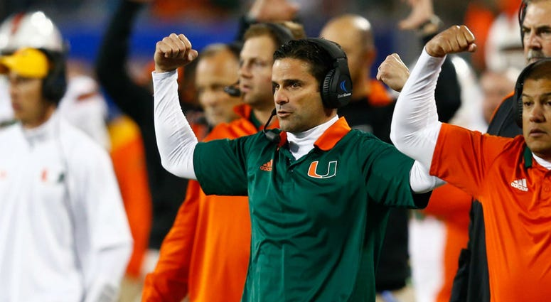Manny Diaz is shown in 2017 as Miami Hurricanes defensive coordinator