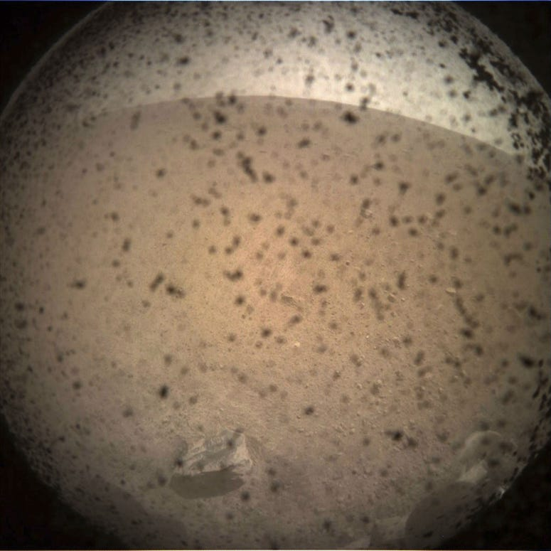 This photo provided by NASA shows the first image acquired by the InSight Mars lander after it touched down on the surface of Mars Monday, Nov. 26, 2018.