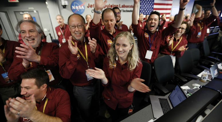 Engineers celebrate as the InSight lander touch downs on Mars in the mission support area of the space flight operation facility at NASA's Jet Propulsion Laboratory Monday, Nov. 26, 2018, in Pasadena, Calif.
