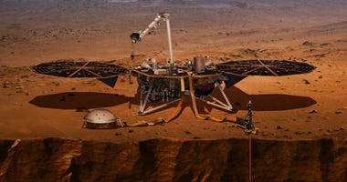 illustration made available by NASA in 2018 shows the InSight lander drilling into the surface of Mars.