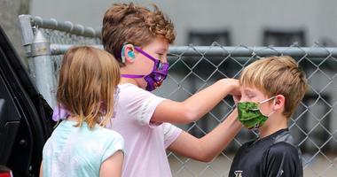 Children wear face masks