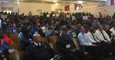 Philadelphia police officers are front and center at this Mastery Parent and  School Action Assembly
