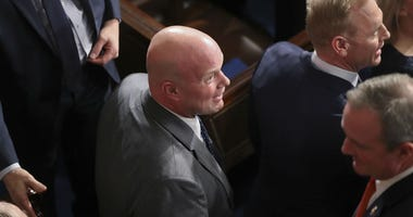 In this Feb. 5, 2019, photo, acting Attorney General Matthew Whitaker and members of President Donald Trump's cabinet arrive to attend the State of the Union address on Capitol Hill in Washington.