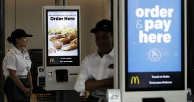 In this Aug. 8, 2018, file photo employees stand in McDonald's Chicago flagship restaurant. McDonald's Corp. reports financial results Tuesday, April 30, 2019.