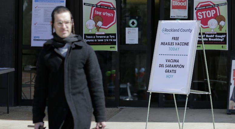 In this March 27, 2019 file photo, signs about measles and the measles vaccine are displayed at the Rockland County Health Department in Pomona, N.Y.