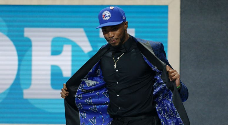 Mikal Bridges (Villanova) walks onto the stage after being selected as the number ten overall pick to the Philadelphia 76ers in the first round of the 2018 NBA Draft at the Barclays Center.