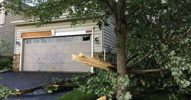 Neighbors wake up to tornado damage in the Valley Ponds development of Morgantown, Pa.