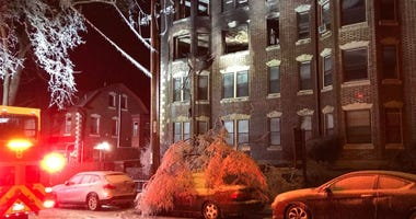 Low temperatures caused the water used fight a fire at Morris Manor Apartments in Germantown to freeze on several cars and trees in front of the apartment building.