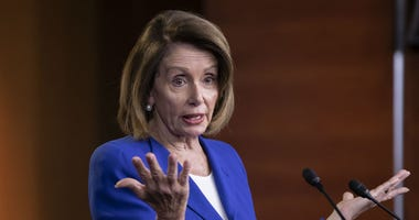 Speaker of the House Nancy Pelosi, D-Calif., talks to reporters during a news conference a day after a bipartisan group of House and Senate bargainers met to craft a border security compromise.