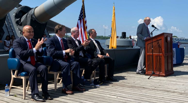 New Jersey Congressman Donald Norcross (second from left) and N.J. Gov. Phil Murphy (second from right) spoke at a Fourth of July naturalization ceremony on the Battleship New Jersey.