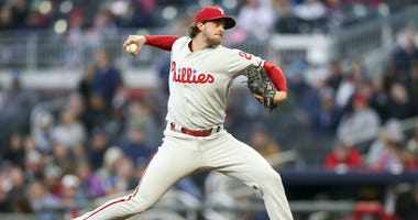 Apr 16, 2018; Atlanta, GA, USA; Philadelphia Phillies starting pitcher Aaron Nola (27) throws a pitch against the Atlanta Braves.