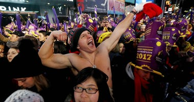 In this Dec. 31, 2016 file photo, Andrew Dickens, 21, of Toledo, Ohio, stands with other revelers during the New Year's Eve celebration in New York's Times Square.