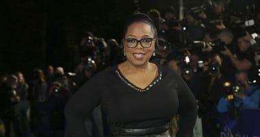 Oprah Winfrey poses for photographers upon arrival at the premiere of the film 'A Wrinkle In Time' in London.