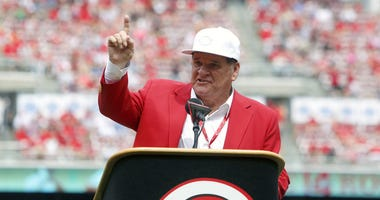 Former Cincinnati Reds player Pete Rose speaks during a pregame ceremony of the unveiling of his bronze statue at Great American Ball Park.