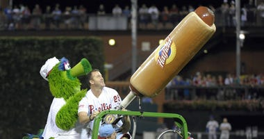 Philadelphia Phillies former player Jim Thome and the Phillie Phanatic shoot hot dogs into the crowd in between innings of game against the New York Mets at Citizens Bank Park on Aug. 9, 2014.