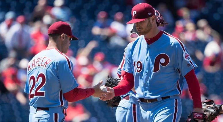 Phillies manager Gabe Kapler (22) takes the ball from starting pitcher Ben Lively (19) for a pitching change during the third inning against the Arizona Diamondbacks at Citizens Bank Park.