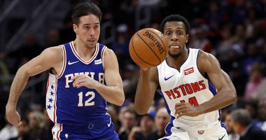 Detroit Pistons guard Ish Smith (14) brings the ball up court ahead of Philadelphia 76ers guard T.J. McConnell (12) during the first half of an NBA basketball game, Tuesday, Oct. 23, 2018, in Detroit.