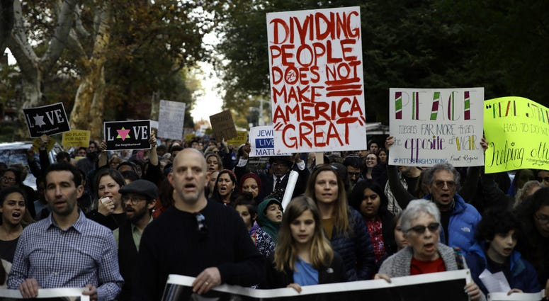 Protesters demonstrate near Pittsburgh's Tree of Life Synagogue where President Donald Trump and first lady Melania Trump were visiting a memorial in Pittsburgh, Tuesday, Oct. 30, 2018.