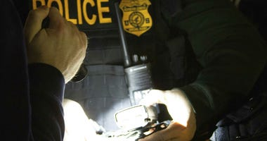 In this photo provided by the Department of Health and Human Services, Office of Inspector General, HHS Office of Inspector General agents, take part in arrests Tuesday, April 9, 2019, in Queens, N.Y.