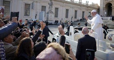 Pope Francis leaves at the end of his weekly general audience, in St. Peter's square, at the Vatican, Wednesday, Nov. 21, 2018.