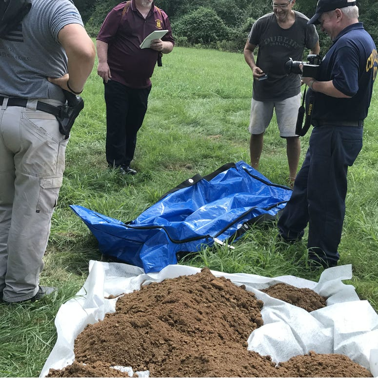 Forensic experts unearth a body buried in a Philadelphia potter's field.