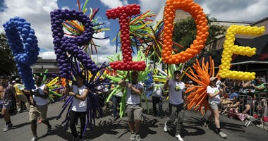 """Marchers hold letters spelling out """"PRIDE"""" in balloons during the 48th annual Chicago Pride Parade in Chicago, Ill. on Sunday, June 25, 2017."""