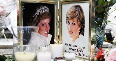 Flowers, candles and photos are seen in commemoration of the Princess Diana in Paris, France on Aug. 31, 2017.