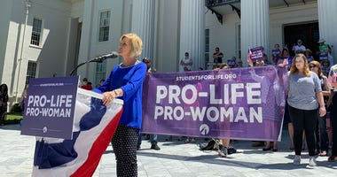 In this Wednesday, May 22, 2019, file photo, Beck Gerritson, president of Eagle Forum of Alabama, speaks at an anti-abortion rally outside the Capitol in Montgomery, Ala.
