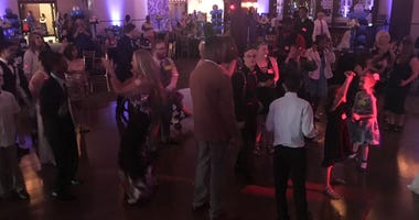 Guests with special needs attend a prom