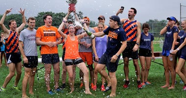 Runners celebrating victory in a previous Mayor's Cup.