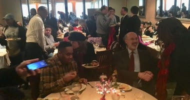 Gov. Tom Wolf (second from right) greets voters at Relish restaurant along Ogontz Avenue before he and other top Democratic politicians voted in York County.