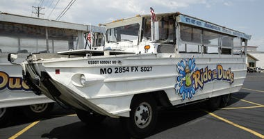 In this July 20, 2018, file photo, a duck boat sits idle in the parking lot of Ride the Ducks, an amphibious tour operator in Branson, Mo.