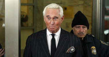 In this Feb. 1, 2019, file photo, former campaign adviser for President Donald Trump, Roger Stone, leaves federal court in Washington.