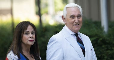Roger Stone, a longtime confidant of President Donald Trump, accompanied by his wife Nydia Stone, left, arrives at federal court in Washington, Tuesday, July 16, 2019.