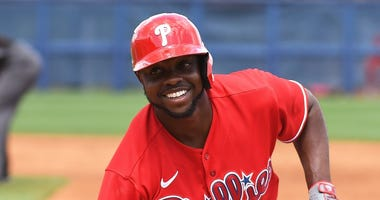 Philadelphia Phillies outfielder Roman Quinn (24) smiles after a pick off attempt in the third inning against the Tampa Bay Rays at Charlotte Sports Park.
