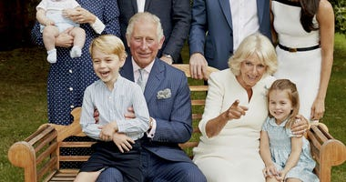 Britain's Prince Charles poses for a portrait to mark his 70th birthday with Camilla, Duchess of Cornwall, Prince William, Kate, Duchess of Cambridge, Prince George, Princess Charlotte, Prince Louis, Prince Harry and Meghan, Duchess of Sussex, in London.
