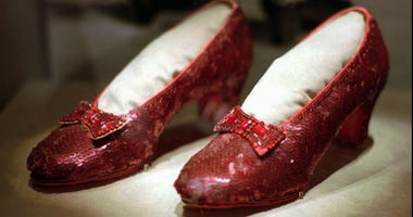 "This April 10, 1996, file photo shows one of the four pairs of ruby slippers worn by Judy Garland in the 1939 film ""The Wizard of Oz"" on display during a media tour of the ""America's Smithsonian"" traveling exhibition in Kansas City, Mo."