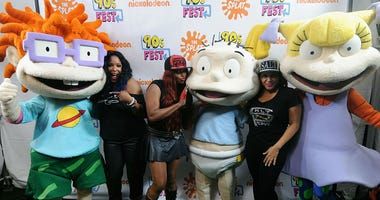 Fro left: Spinderella, Pepa and Salt pose with Rugrats at 90sFEST Pop Culture and Music Festival on September 12, 2015 in Brooklyn, New York.