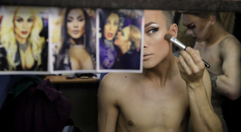 In this picture taken Sunday, June 24, 2018, Andrei, who uses the stage name Star Vasha, applies make up before performing at a gay club during the 2018 soccer World Cup in Yekaterinburg, Russia.