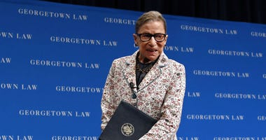 In this Sept. 26, 2018, file photo, Supreme Court Justice Ruth Bader Ginsburg leaves the stage after speaking to first-year students at Georgetown Law in Washington.