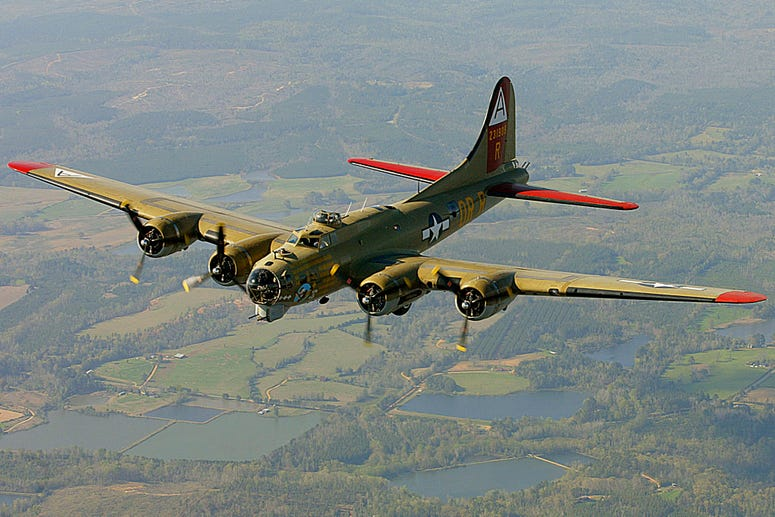 In this April 2, 2002, file photo, the Nine-O-Nine, a Collings Foundation B-17 Flying Fortress, flies over Thomasville, Ala., during its journey from Decatur, Ala., to Mobile, Ala.