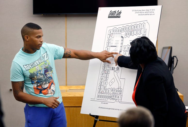 Botham Jean's neighbor Joshua Brown, left, answers questions from Assistant District Attorney LaQuita Long, right, while pointing to a map of the South Side Flats where he lives.