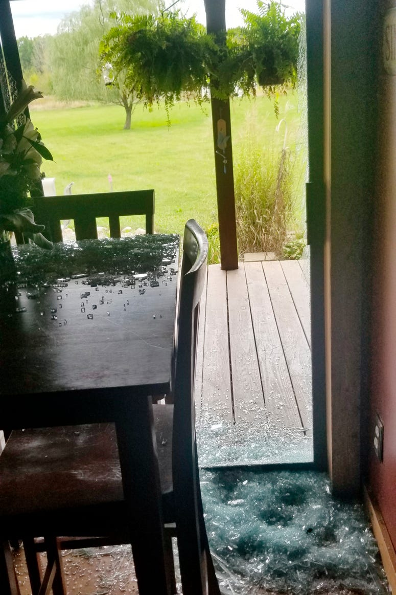 Broken glass from a sliding door is shown at a home in Sullivan Township, Ohio.