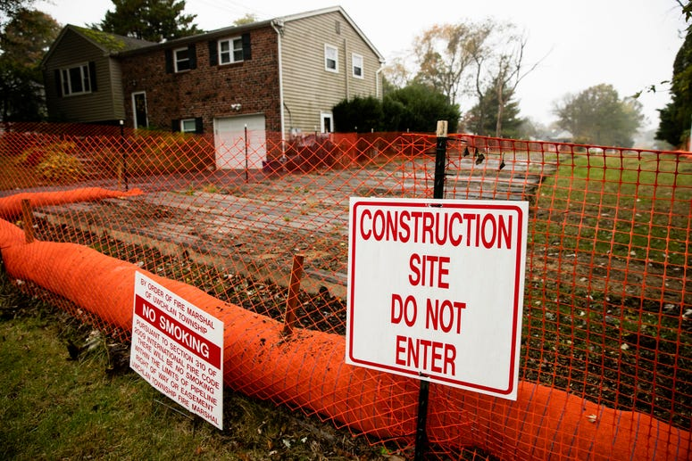 a sign is posted at a construction site on the Mariner East pipeline in a residential neighborhood in Exton, Pa.