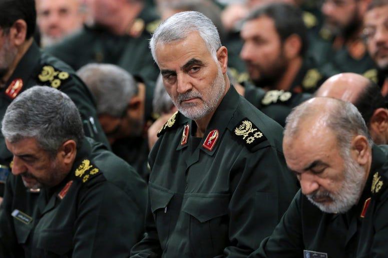 Revolutionary Guard Gen. Qassem Soleimani, center, attends a meeting in Tehran, Iran.