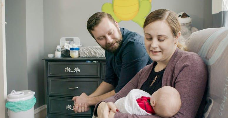 Jennifer and Drew Gobrecht look at their baby, Benjamin.